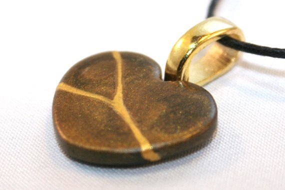 Brown broken heart kintsugi-inspired pendant
