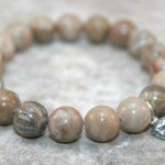 Fossil coral stacking stretch bracelet with sterling silver arrowhead charm