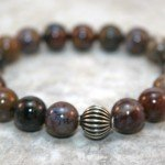Pietersite stacking stretch bracelet with antiqued sterling silver corrugated round focal bead