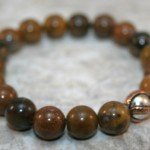 Wooden agate stacking stretch bracelet with antiqued sterling silver and copper focal bead
