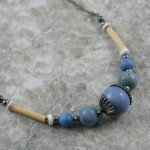 Light blue wood, bamboo, and shell necklace with gunmetal black accents and chain