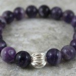 Banded amethyst stacking stretch bracelet with sterling silver corrugated accent bead