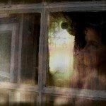 woman waiting by window