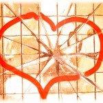 heart drawn on broken glass