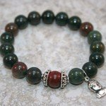Indian bloodstone stacking stretch bracelet with brecciated jasper accent and sterling silver Buddha charm