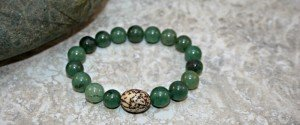 African jade stacking stretch bracelet with betel nut focal bead