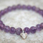 Amethyst stacking stretch bracelet with Hill Tribes fine silver leaf charm