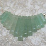 Green aventurine stone fan on silver plated chain