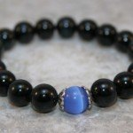 Blue tigereye stacking stretch bracelet with blue glass cats eye accent