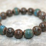 Brown snowflake jasper stacking stretch bracelet with turquoise ceramic accent beads and antiqued copper-plated brass bead caps