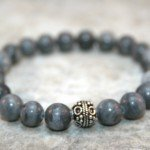 Black and grey marble stacking stretch bracelet with an antiqued sterling silver focal bead