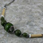 Light forest green wood, bamboo, and shell necklace with gunmetal black accents and chain