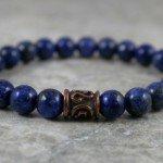 Lapis lazuli stacking stretch bracelet with a bronze plated Greek spiral key barrel focal bead