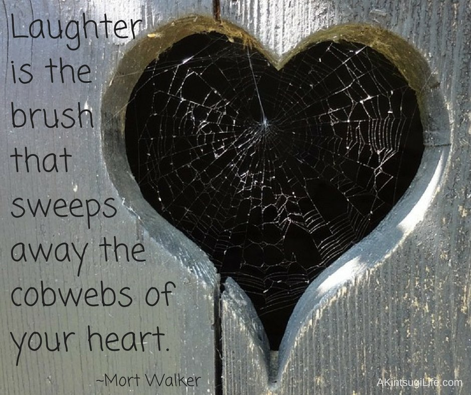 Heart shaped opening filled with cobwebs