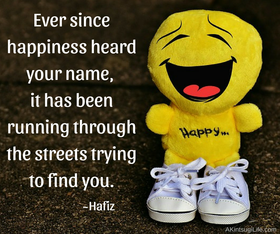 "smiling yellow plush doll with running shoes and ""Happy"" on chest"