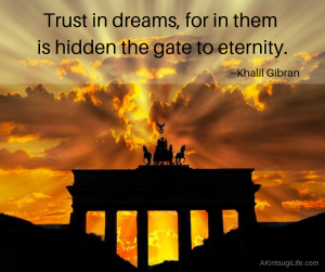 Brandenburger Tor gate with sunrise behind it