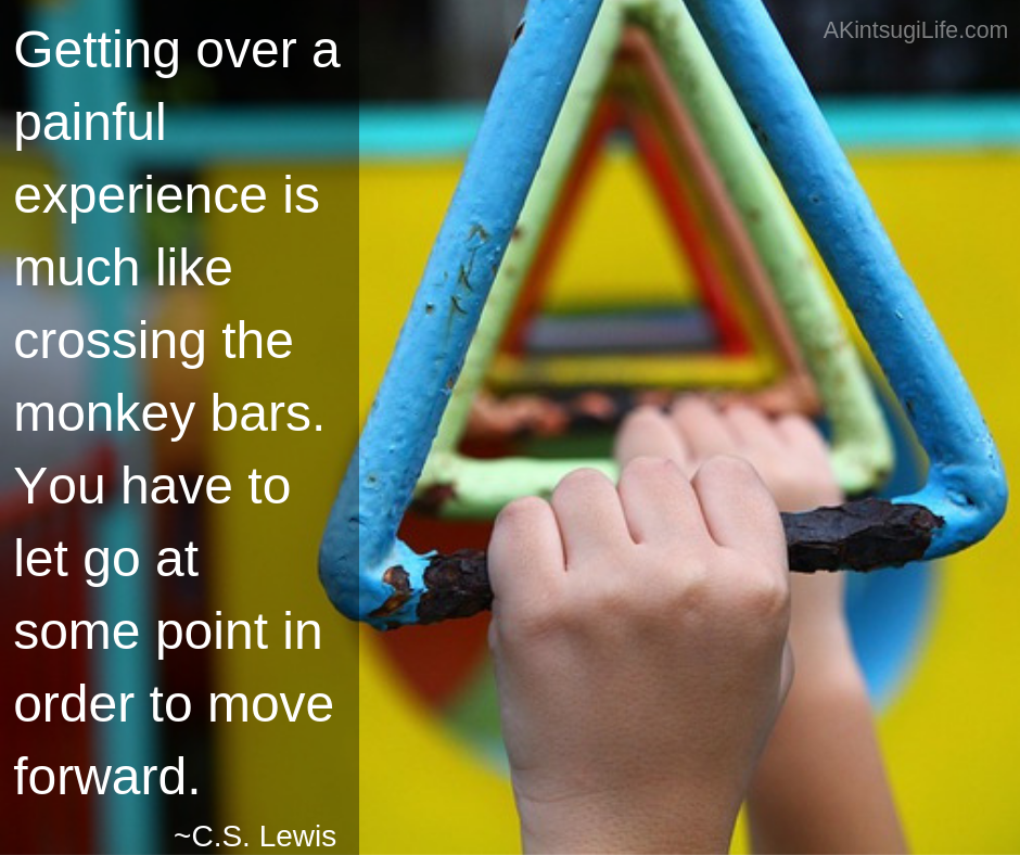 child's hands on monkey bars